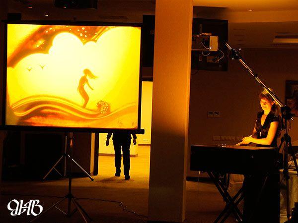 Песочное шоу на свадьбе в отеле «Ramada».