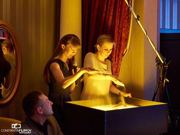 Песочное шоу на презентации компании «Grottbjorn».